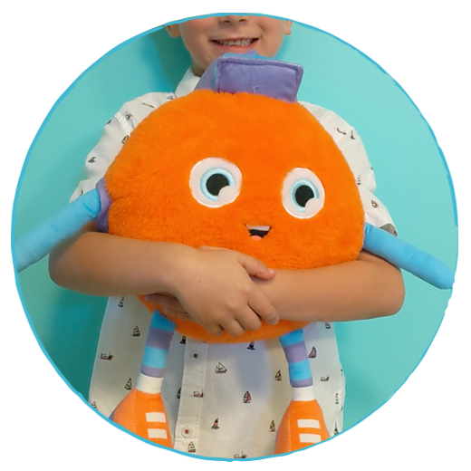 A child hugging a Watchum stuffy